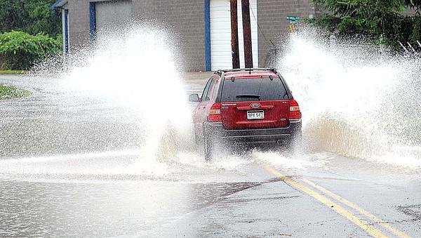 High water on Whitestick Street in Manscott.<br /> Rick BArbero/The Register-Herald
