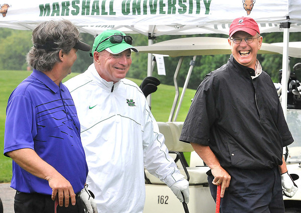 Marshall coaches, Doc Holliday, center, greets Victor Flanagan, left, and Charlie Houck and on the par 3, 15th hole at Grandview Country Club during the Big Green golf outing.<br /> Rick Barbero/The Register-Herald