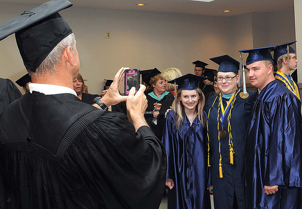 Shady Spring Graduates take some last minute photos before Friday's graduation at the Beckley-Raleigh County Convention Center. F. Brian Ferguson/The Register-Herald