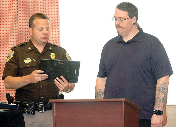 Beckley Police Chief Tim Deems, left, presents a plaque for Outstanding Citizenship to James Tate for his courageous actions on Friday, May 17th during a domestic dispute at the Beckley Plaza Mall. F. Brian Ferguson/The Register-Herald