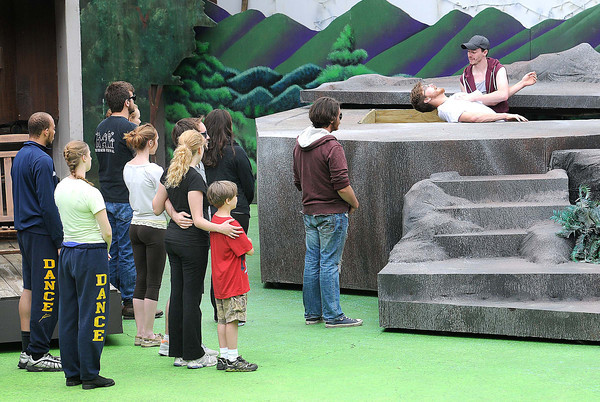 Theatre WV actors rehearse the ending baptism scene for the Hatfield's and McCoys's musical.<br /> Rick Barbero/The Register-Herald