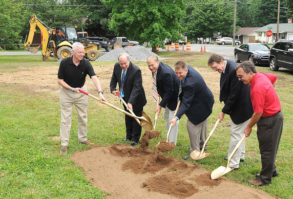 Beckley Sanitary Board held a groundbreaking ceremony for the Thomas H. Keyser Memorial Rain Garden in the triangle at the intersection of Tolley & Holliday Drives and Painter Road Street in Maxwell Hill. Breaking ground from left, Wayne Davis, board member, Beckley mayor, Emmett Pugh, John Keyser, son of Tom Keyser, Jeremiah Johnson, general Manager, John Sadowski, board member and John Peplowski, operation manager.<br /> Rick Barbero/The Register-Herald