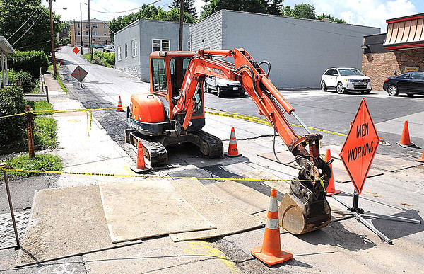 sinkhole that formed in the road on Piney Avenue near Wendy's and the Valley Drive Barbershop. This sinkhole is the result of Monday evening's storm.<br />  Rick Barbero/The Register-Herald