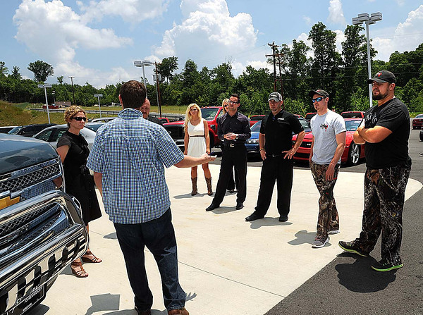 The cast of Mayham joined employees of Crossroads Chevy to film a commercial on Wednesday afternoon. F. Brian Ferguson/The Register-Herald