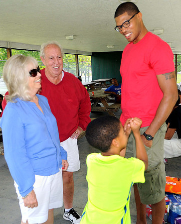 Gelilah Barksdale, left, and her husband Coach Barksdale meet former Woodrow Wilson High School Basketball star Tamar Slay, right, and his son, Bryce Slay, 7. during a Saturday cookout at New River Park. Slay was a graduate of the class of 1998. F. Brian Ferguson/The Register-Herald