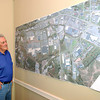 Bill Baker looks over the East Beckley Bypass map.<br /> Rick Barbero/The Register-Herald
