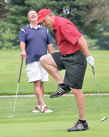 Bo Kaminski, reacts after just missing a birdie putt on the par 3, 7th hole at Grandview Country Club, during the 16th Annual YMCA Golf Outing. Teammate Ross also reacted in the background and followed up by making the 20ft birdie putt.<br /> Rick Barbero/The Register-Herald