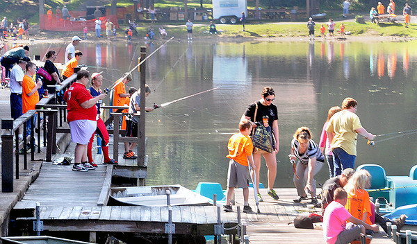 The decks were full of children and parents as they cast their lines during Saturday's Kids Fishing Derby at Little Beaver State Park. F. Brian Ferguson/The Register-Herald