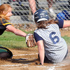 Greenbrier East Pitcher #16 misses with the tag as Shady Soring's #6 scores on a passed ball during Thursday afternoon action in Shady Spring. F. Brian Ferguson/The Register-Herald