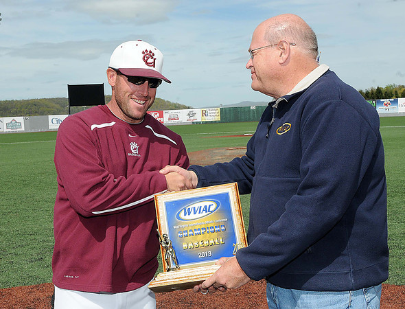 Concord Unversity coach Andrew Wright, left, receives the championship trophy from Barry Blizzard after beating West Virginia State Unversity 11-4 in the championship game.<br /> Rick Barbero/The Register-Herald