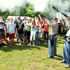 Joe Bevins, left, and Nick Harrison, both dressed as Confederate soldiers for the Wyoming County Civil War Days in Oceana, gave a demonstration to school children on the field behind Oceana Middle School.<br /> Rick Barbero/The Register-Herald