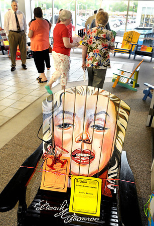 The timeless face of Marilyn Monroe was portrayed on one of the chairs at the Annual Chairity Auction, to benefit the Women's Resource Center, held Friday evening in the Lewis Automotive Showroom F. Brian Ferguson/The Register-Herald