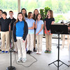 Andrea Sullivan, music teacher Greater Beckley Christian School, right, and the 5th grade class, sing Shine Jesus Shine during Friday's in the Park at Jim Word Park on Neville Street in Beckley.<br /> Rick Barbero/The Register-Herald