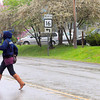 Sophia residents try to stay dry as they cross Main Street while the area seems to be seeing April Showers in May. F. Brian Ferguson/The Register-Herald