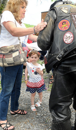 Rainelle resident Linda Robinson, left, and her Granddaughter, Adah Robinson, 4, take time out to thank a Veteran during the 25th year during Thursday's Run for the Wall Event. F. Brian Ferguson/The Register-Herald