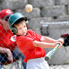 F. BRIAN FERGUSON/THE REGISTER-HERALD=Caleb Williams gets a bases loaded hit during Saturday's Opening Day of Sophia Little League.