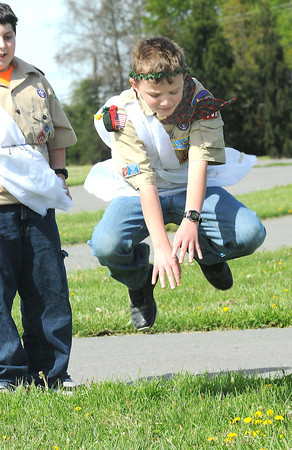 Jason McClung, does the trible frog jump during the Seneca District Olympics held at the State Fair ground in Fairlea. <br /> Rick Barbero/The Register-Herald