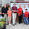 F. BRIAN FERGUSON/THE REGISTER-HERALD=The official Grand Opening of Grant's Supermarketwas held Saturday in Oak Hill. (From left) Damita Johnson, Oak Hill City Manager Bill Hannabass, Oak Hill Mayor Bill Dickinson, Councilwoman Diana Janney, Grant's Owner Ron Martin. Manager Bob Black, Tom Oxley, Wyatt Oxley, Grant's Owner Ronnie Cruey, and Owners Rosemary and Randle  Grant.