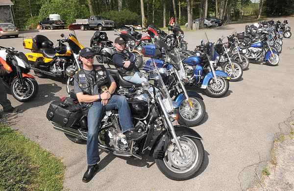 Jeremy Young, left, and Chuck Knoll, both with WV Iron Shields, rest on there bikes in the parking lot of Daniels Vineyard. They participated in the Ride for the Red-Southern West Virginia Tour, a motorcycle fundraiser aimed at benefiting the vital programs and services offered by the American Red Cross West Virginia Region.<br /> Rick Barbero/The Register-Herald