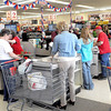 F. BRIAN FERGUSON/THE REGISTER-HERALD=It was another busy day during the official Grand Opening of Grant's Supermarketon Saturday in Oak Hill.