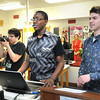 Chase Davis, left, videos Isaac Fadiga and Dylan Harvey's presentation of their own computer game they degigned in Sherri Morgan's Game Design 1 class at Woodrow Wilson High School.<br /> Rick Barbero/The Register-Herald