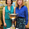 Lisa Shrewsberry, Editor WV South, left, and Community Newspaper Holdings Inc. President and CEO Donna Barrett, stand behind the trophy WV South magazine won. <br /> Rick Barbero/The Register-Herald