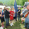 Phil Bevins, right, dressed as confederate soldiers for the Wyoming County Civil War Days in Oceana, plays his fiddle to school children on the field behind Oceana Middle School.<br /> Rick Barbero/The Register-Herald