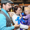 Will Davis, Funnybones Family Entertainment, left, interacts with April Trent and her daughter Bella Trent, 2, during the Raleigh County Chamber of Commerence business show held at the Beckley-Raleigh County Convention Center.<br /> Rick Barbero/The Register-Herald