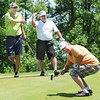 Buddy Crowder sank a birdie putt on the par 4 third hole at Brier Patch Golf Course during the Beckley Health Right captains choice golf tournament. Reacting in background, Tim Erwin, left, and Rocky Mckinney.<br /> Rick Barbero/The Register-Herald