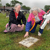 Patricia Hamons, left, and Jeanette Daniel, right, put a cross on the grave of their Grandfather and Father, Private Charles J. Holliday, on Friday morning at The American Legion cemetery on South Kanawha Street in Beckley. Holliday served our country in Europe during World War I. F. Brian Ferguson/The Register-Herald
