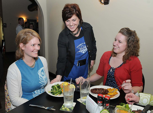 Kenette Coffman, owner Shear Style in Beckley, center, serves Megan Lilly, left, and Lacey Andrews, at The Dish Cafe in Daniels, during Celebrity Night.<br /> Rick Barbero/The Register-Herald