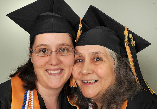 Jennifer Barrett, 32, left, and Ivy Dawson, 62, of Crab Orchard, daughter and mother, both graduated from New River Community & Technical College. Ceremony was held at the Chuck Mathena Center in Princeton.<br /> Rick Barbero/The Register-Herald