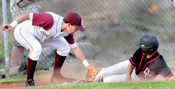 Woodrow Wilson 3rd Baseman #16 is late with the tag as Oak Hill's #8 slides safely into third during Thursday evening action in Shady Spring. F. Brian Ferguson/The Register-Herald