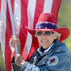 Rainelle Mayor Andrea Pendleton proudly waved the red, white, and blue on Saturday during the Rainelle Veterans Reunion parade.F. Brian Ferguson/The Register-Herald