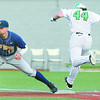 Ryan McBroom, left, of WVU, forces out Nathan Gomez, of Marshall, at first base during the game at Linda K. Epling stadium in Beckley Tuesday night.<br /> Rick Barbero/The Register-Herald