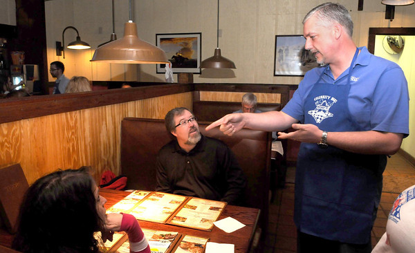 F. BRIAN FERGUSON/THE REGISTER-HERALD=Mary and Herb Wills hear the menue items from BB&T's Tim Stevens, right, at the Texas Stakehouse during Monday's Celebrity Night event.
