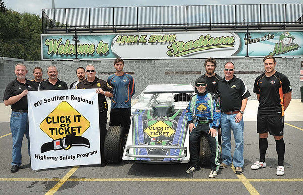 Staff from the WV Miners, WV King's Warriors, and Beckley Motorsports Park help kick off the Click It or Ticket enforcement campaign. Pictured from left, Dr. Jim Blume, King's Warriors, Andrew Dailey, King's Warriors, Gary Pollard, WV Miners, Scott Reitnour, King's Warriors, Lt. Paul Blume Southern Regional Highway Safety Program Coordinator, Eric Mozzo, King's Warriors, Michael Moore, racer Beckley Motorsports Park, Carter Robbins, King's Warriors Tim Epling, WV Miners and Harry Sherwood, King's Warriors<br /> Rick Barbero/The Register-Herald
