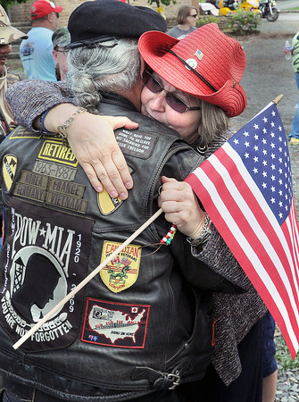 """Retired Army Ranger Veteran, Joe Dragon, left, gets a """"Welcome to his Home Away From Home"""" from retired Rainelle Elementary School Principal, Monica Venable during Thursday's Run for the Wall Event in Rainelle. The two first met during the first year of the 25th Annual Event. F. Brian Ferguson/The Register-Herald"""