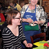 F. BRIAN FERGUSON/THE REGISTER-HERALD=Michelle Kubiak, left, has her order taken by Celebrity Night Founder Judy Harrah, right, at Fosters during Monday's Celebrity Night event.