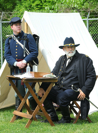 Patrick Parker, dressed as Capt. Ferdinand Neumann, left, and Danny Culver, as Ulysses S, Grant, reenactors for the Wyoming County Civil War Days in Oceana, spoke to school children on the field behind Oceana Middle School.<br /> Rick Barbero/The Register-Herald