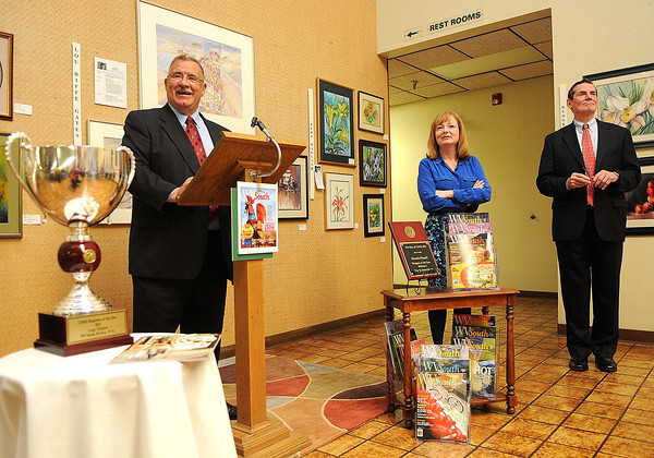 Beckley Newspaper Publisher, Frank Wood, left, Community Newspaper Holdings Inc. President and CEO Donna Barrett and CNHI Senior VP for News William Ketter, speak during the WV South awards brunch in the lobby of Beckley Newspapers.<br /> Rick Barbero/The Register-Herald