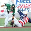 Robert Tavone, of WV Miners slides safe into second base and trying to make the tag is Gentry Kinsella, of Slippery Rock.<br /> Rick Barbero/The Register-Herald