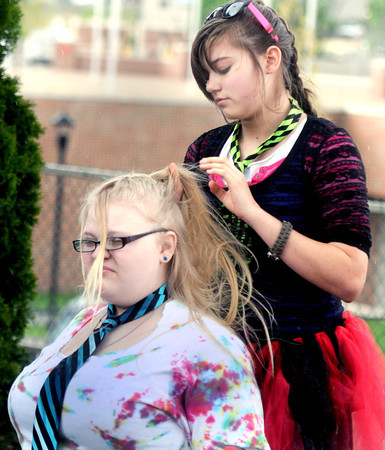 Independence High School's Sabrina Farley, left, and Morgan Walker, right, get ready to take the stage at Word Park during Saturday's Raleigh County Schools Day of the Arts. F. Brian Ferguson/The Register Herald
