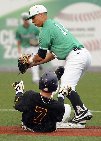 Andrew Dundon, 14, of Marshall, forces out Drew Reynolds, 7, of East Carolina at second base. <br /> Rick Barbero/The Register-Herald