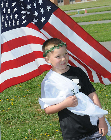 Carter Hamilton, getting ready for the Cub Scouts Seneca District Olympics held at the State Fair ground in Fairlea <br /> Rick Barbero/The Register-Herald