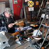 F. BRIAN FERGUSON/THE REGISTER-HERALD=Craftsman David Milam of Oak Hill demonstrates his wood work during Saturday's Grand Opening of the White Oak Depot Artisan Gallery and Heritage Center.