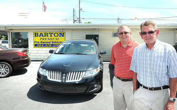 From left, Chase and Dave Barton, owners of Barton Premium Pre-Owned Vehicles on Johnstown Road in Beckley.<br /> Rick Barbero/The Register-Herald