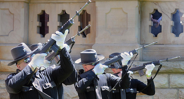 """The Fayette County Sheriff Color Guard fires off a 21-Gun Salute in front of the Fayette County Courthouse on Wednesday for the FOP""""s Annual Police Memorial Service.F. Brian Ferguson/The Register Herald"""