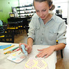 Emma Ellis, 14, of Fayetteville works on painting her flip flop plaque at The Pottery Place at Galleria Plaza in Beckley.<br /> Rick Barbero/The Register-Herald