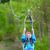 Mrs. Haley Cox Bonds, a 88 year-old Grandmother, takes in the zipline during Mother's Day Weekend events at Burning Rock on Saturday. F. Brian Ferguson/The Register Herald